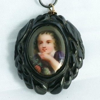 VICTORIAN Whitby jet pendant set with hand-painted porcelain plaque of a young boy portrait