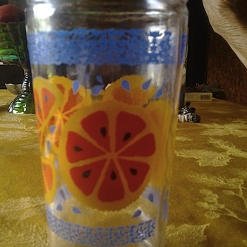 glass with orange decals