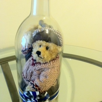 OLD TEADY BEAR IN A LARGE BOTTLE IN GOLF CLOTHES AND EQUIPMENT