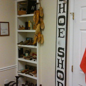 Shoe/foot collection in my office - Advertising