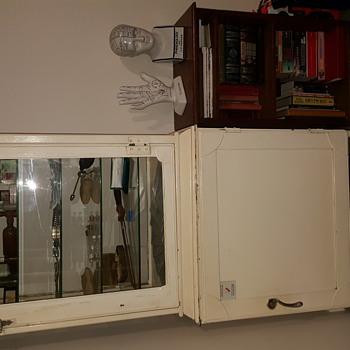 1930s medical instrument cabinet.