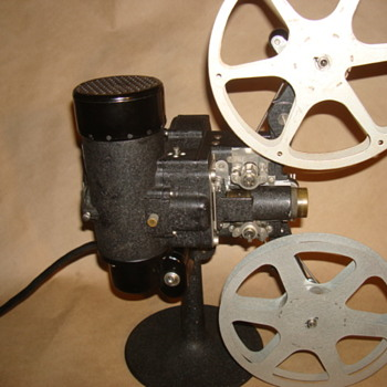 Circa. 1928 Filmo 8mm Projector with storage box.