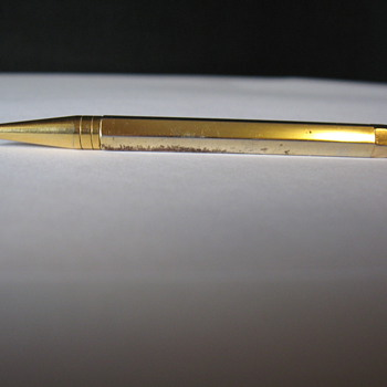 VINTAGE BRASS PENCIL WITH AQUAMARINE JEWEL