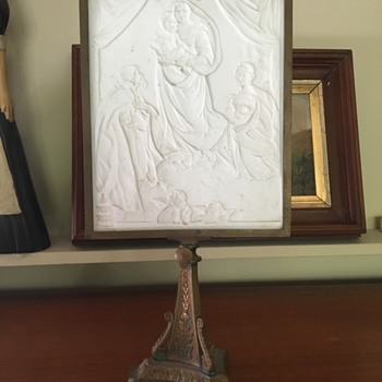 Bas relief panel on stand