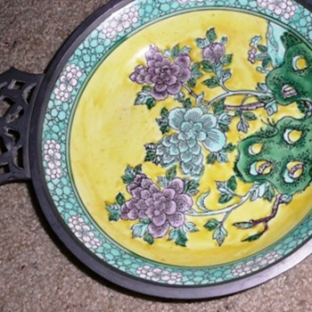 Oriental plate incased in a metal - Asian