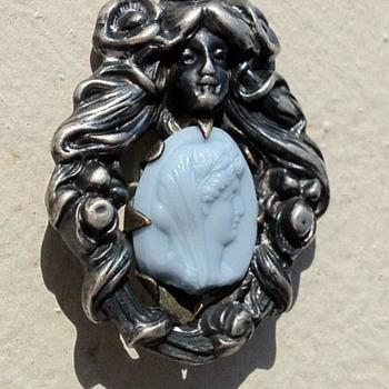 Art Nouveau repousse brooch, stone insert info