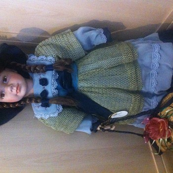 My oldest porcelain doll I've had from a child