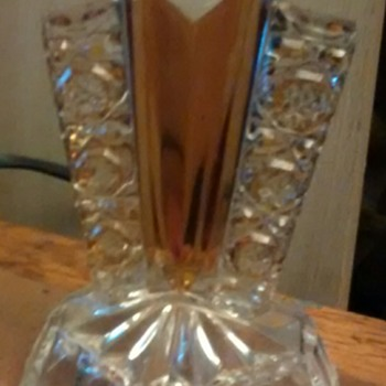 Candlestick 6 inches tall glass, hollow base with wings and a central amber section.