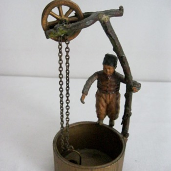 Antique Man Standing on Well w/ Bucket Chain - Figurines