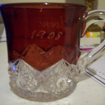 Colored, cut glass mug