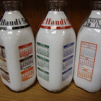 Square calendar milk bottles..1948, 1949, 1966