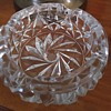 Glass ashtray with eight point star in the center.