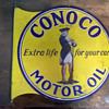 1920&#039;s Conoco Motor Oil sign w/ Minuteman
