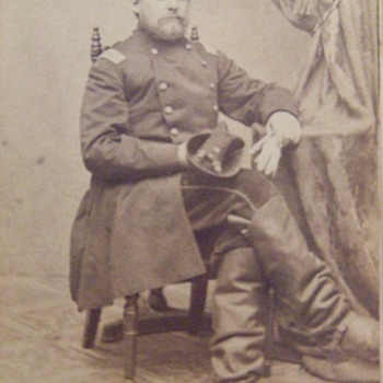 CDV of a Civil War officer with a pistol stuck in his boot - Photographs