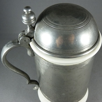 A continental porcelain pewter mounted tankard. Early 19th. Century ?