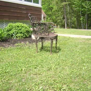 Antique cast iron chair
