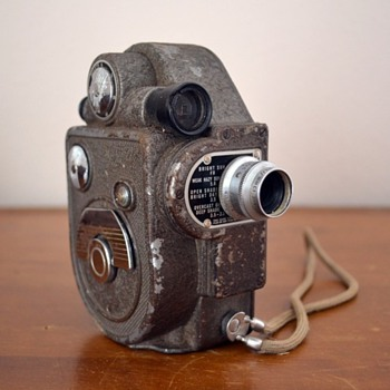 Two very old Revere movie cameras from the 1930's.