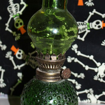 Small, green oil lamp