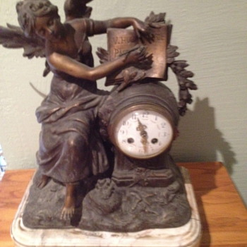 Antique French mantel clock. Cast angel writing V. Hugo Pasteur.  - Clocks