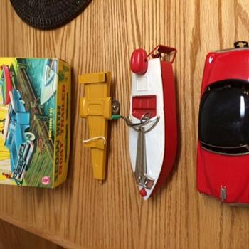 Vintage Friction Toy tin/metal Sedan, with windup friction tin/metal boat and 2 wheeled tin/metal boat trailer - Toys