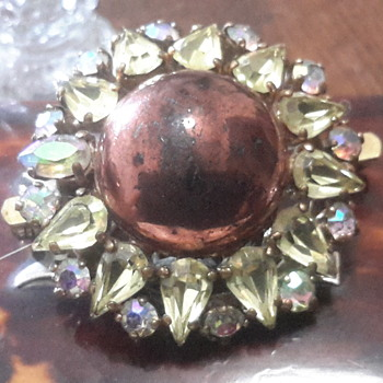 1950s Paste stone brooch with a  central domed cabochon