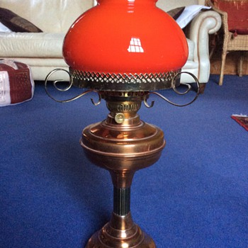 Red glass lamp with copper base