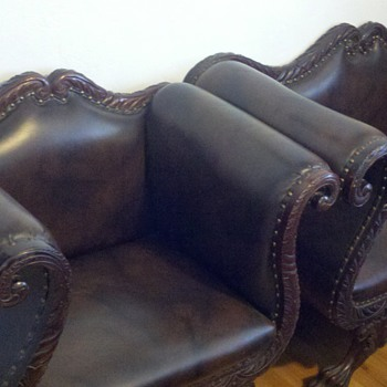 Antique camel back loveseat and chair.