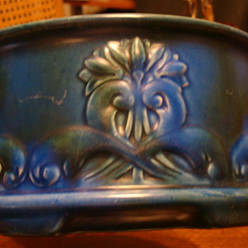 Blue bowl with a rising sun sign on the bottom - Art Pottery
