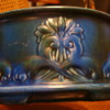 Blue bowl with a rising sun sign on the bottom