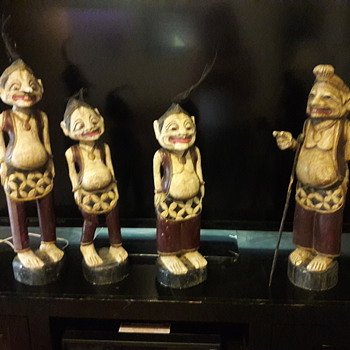 carved teak wood antique statues