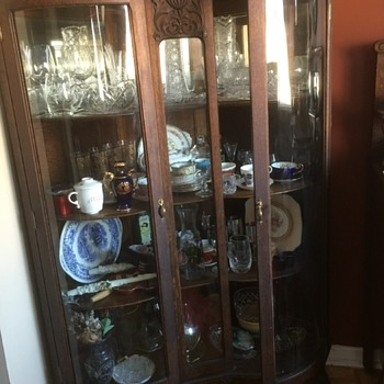 Canadiana:  Curved glass china cabinet - 1904