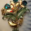 Early floral figural enamel rhinestone brooch.