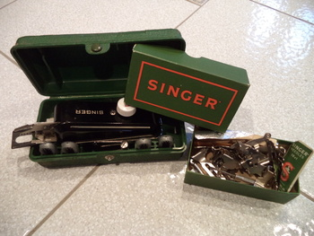 small held sewing machine