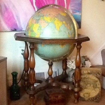 Replogle 20 inch illuminated floor globe with beautiful walnut stand acquired at an inner city Chicago thrift store.