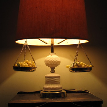 Old Lamp with weight balance and green grapes