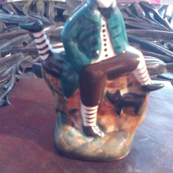 An unusual Rushton Pottery Isle of man posy vase man