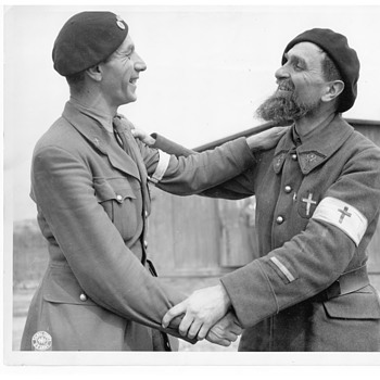 WWII Belgian Chaplain & French Chaplain congratulating each other on being liberated from Nazi POW Camp by U.S. Army, 1945