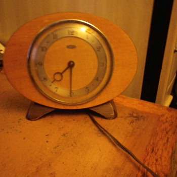 Metamec made in Dereham UK, Oval or Rugby shaped electric clock wood and metal. - Clocks