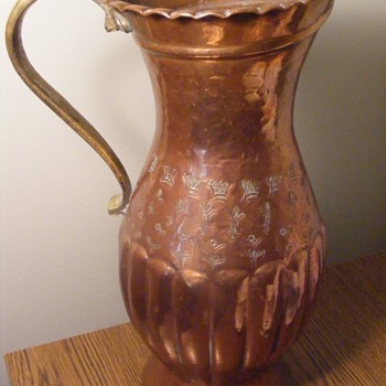 Cooper Pitcher not sure if it is hand hammered or not