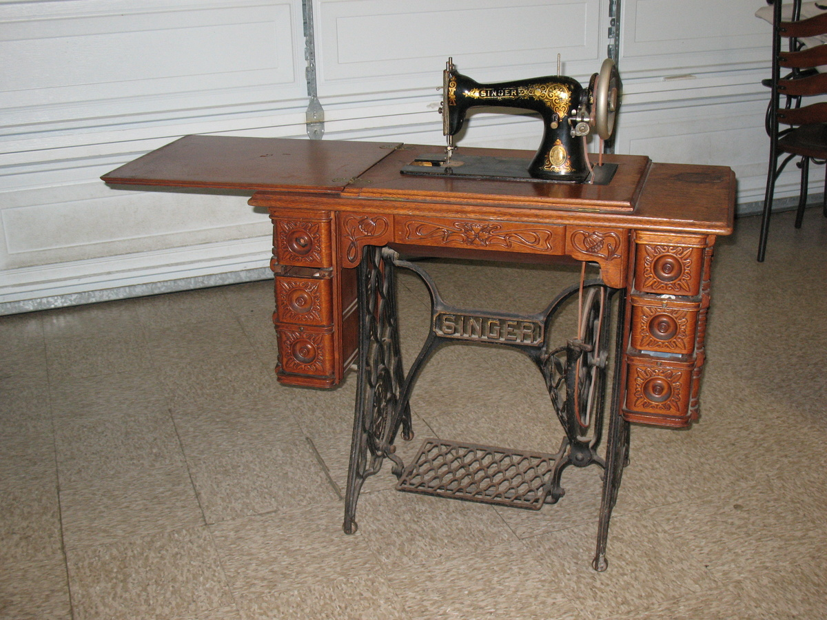 Singer Sewing Machine In Original Cabinet