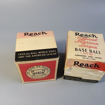 Two Reach baseballs one signed by a team, both unused and both have boxes