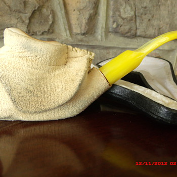 A Meerschaum Hand Carved Pipe with Cover still on.
