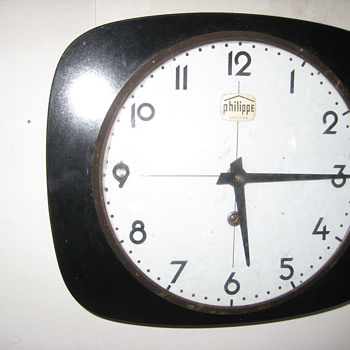 Antique 1940's Russian Philippe wall clock.