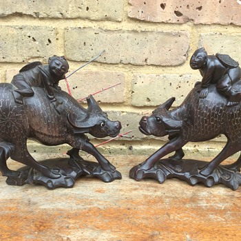 Pair of 1920's Chinese wooden bull figures inlaid