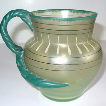 A very unusual Loetz Olympia pitcher!