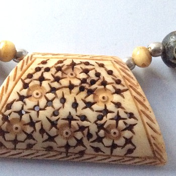 Antique netsuke necklace?