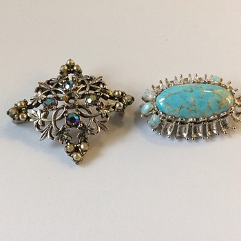 Damaged antique brooches