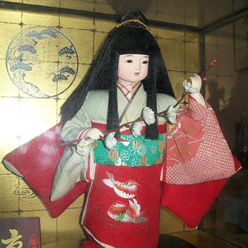 Japanese doll with Cherry Blossom