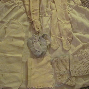Baby clothes found in old steamer trunks.
