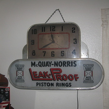 old auto parts lighted clock sign